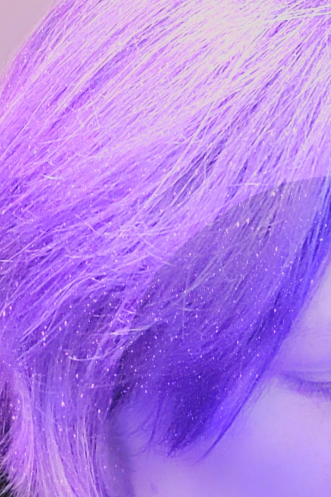 A close-up of a woman's lavender-violet hair.