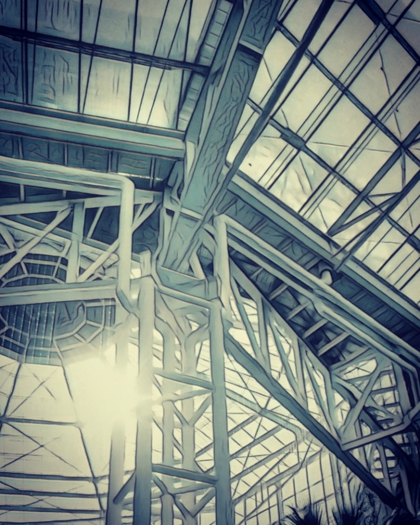 An image of the interior scaffold structure of a huge greenhouse.