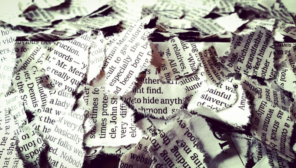 Photograph of shredded bits of newspaper piled in a heap.