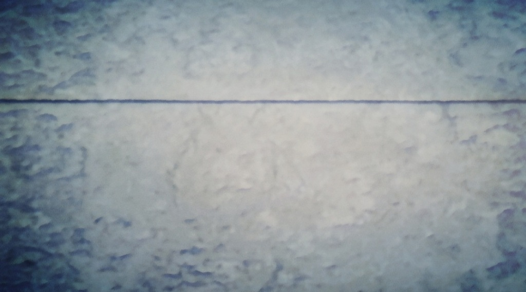 An abstract photo representing a gray sky hung above a gray sea.